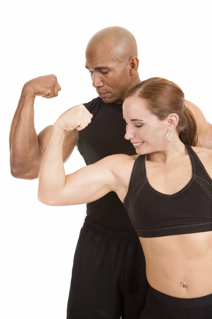 Couple looking at their muscles.